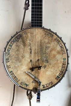 """this machine surrounds hate and forces it to surrender"" on Pete Seeger's banjo"