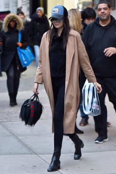 19 February Kendall Jenner was cool and casual in New York City in a camel coat, Sandro boots and a Givenchy handbag. - HarpersBAZAAR.co.uk