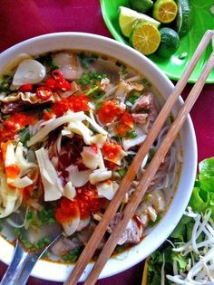 Bun cha  ( Jessica Gelt / Los Angeles Times / March 8, 2012 )  A piping hot bowl of bun cha, from a street stall in Hanoi's Old Quarter. The combination of grilled pork, sweet and savory broth with fish sauce, sliced green papaya, rice noodles and fresh herbs is the signature dish of Hanoi.
