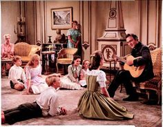 Captain Von Trapp (Christopher Plummer) is singing 'Edelweiss' with his children.