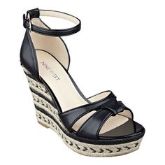 """Our Jacoby retro-inspired sandals feature a striped espadrille wedge fashioned with a sleek, slender ankle strap with adjustable buckle closure for a perfect fit. Padded footbed for all-day comfort. Leather upper. Man-made lining and sole. Imported. 1 1/4"""" platform. 4 1/4"""" wedge heels."""