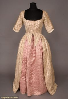 IVORY BROCADE OPEN GOWN, 1780s. Silk satin with striped extra warp in self color and center overlaid with tiny green and salmon flowers, narrow looped fringe trim, wide, rounded square neckline, fitted and shaped sleeves, center front brass hook & eye closure, skirt front open to reveal petticoat (missing), skirt knife pleated and attached to bodice at sides and back, four linen tapes inside skirt; if tied skirt becomes a polonaise, homespun linen bodice and sleeves lining.