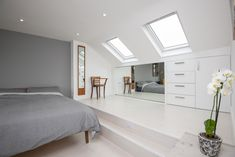 Adding a mirror to a dormer loft conversion master bedroom can create an illusion of a larger space.   Built by Simply Loft for a client in South East London. Loft Conversion Design, Loft Conversion Bedroom, Dormer Loft Conversion, Loft Conversions, Eaves Storage, Loft Storage, Loft Room, Bedroom Loft, Bedroom Small