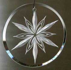 Hand Engraved Crystal Ornament by Catherine Miller of Catherine Miller Designs* Technique-stone wheel* engraved both sides