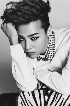 "G-Dragon (지드래곤) of Big Bang (빅뱅) There are not enough words nor enough ways to even begin to explain how much this man inspires me. He promotes such a positive and motivational message to his listeners. Everything this man touches seems to become gold. So talented and truly ""One of a Kind""."
