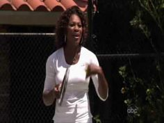 Shaquille O'neal playing tennis with Serena Williams