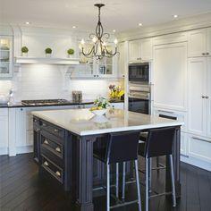 J. Glass kitchen with dark diagonal hardwood floor and dark island