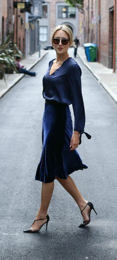 incorporating fall trends into your work wardrobe with this navy satin blouse, navy velvet fit and flare midi skirt, and classic ankle strap pumps (Click for product details!)