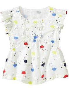 Bought this for Torra today, WAY cuter in real life. The white is an off white, not as bright as it looks here. I's got a vintage flair to it. Cute with her polka-dot skinny jeans and leggings.