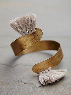 american handmade brass spiral armband with hand-spun tassel trims.