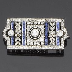 A belle époque sapphire and diamond brooch, circa 1910  The rectangular plaque finely pierced and millegrain-set with single-cut diamonds, set to the centre with three graduated old brilliant-cut diamonds interspersed with single-cut diamond floral decoration and courses of calibré-cut sapphires, diamonds approx. 2.00ct. total, width 4.1cm., fitted case
