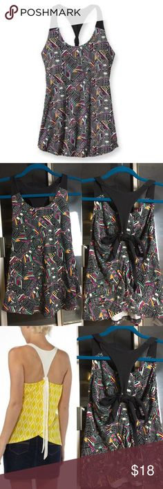 ✨ Patagonia XS Geometric Kamala Tie Racerback✨ ✨ Patagonia XS Tribal Print Kamala Tie Tulip Racerback✨ Has a unique adjustable tie back with a tulip overlapping opening✨ Gently Used, great condition ✨ light support SPORTS BRA BUILT IN✨This item is Sold Out✨ Loose Fitting✨ Fits and XS or S✨ Patagonia Tops Tank Tops