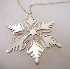 Snowflake necklace made of Sterling Silver.  The pendant size is 4cm (1.6) diameter, and it is suspended on a delicate sterling silver chain.  The
