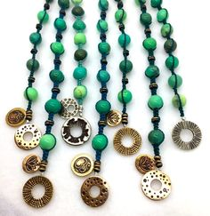 Saki toggles, charms and bronze beads with macrame. www.sakisilver.com