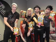 The members of New Years Day enjoy Cobra Corn at the Backstage Artists Lounge.