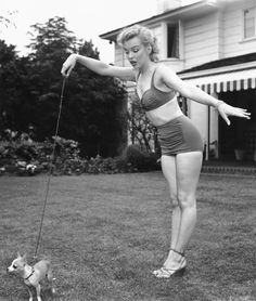 marilyn walks her dog in a bikini and wedges...of course she does.