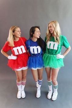 """Gather a group of friends — the more the merrier — and have everyone choose their favorite candy color. Purchase white gloves, solid-colored tutus and suspenders and striped knee-high socks (available at party stores). Either buy or reuse solid-colored T-shirts to match the color of your M&Ms and white shorts to wear under your tutus. Cut out this free printable letter """"m,"""" trace on white felt (available at craft stores) and adhere to your T-shirt with hot glue."""