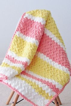Try this easy and quick striped afghan free crochet pattern. This fast baby blanket will only take few hours and is great for a last minute gift. The textured stitch pattern is simple and perfect for beginners. Crochet Baby Blanket Free Pattern, Baby Afghan Crochet, Manta Crochet, Crochet Bebe, Afghan Crochet Patterns, Free Crochet, Baby Afghans, Crochet Owls, Kids Crochet