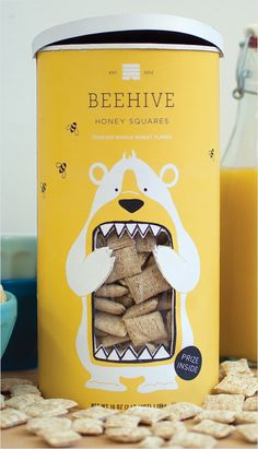 Concept Branding and Packaging: 'Beehive Honey Squares'. The use of yellow on the outside of the packaging gives across a very happy and bright appeal. Also with the illustration of the cartoon bear and the use of yellow this can trigger childhood memories with the buyer.