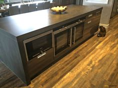 Niemann kitchen with Neolith island top and Legrabox soft close drawer system. Flowing into dining area.