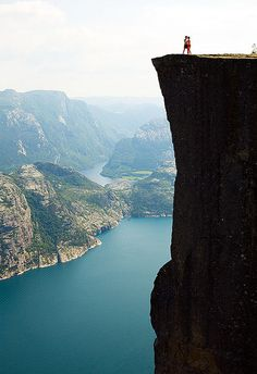 Norway..... one of the most beautiful places people forget about.  I love the couple standing on the edge of the cliff. I could totally see Mark & I doing that. Love to be daring.  *kls