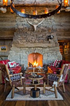 Western style lodge. Love the stone fireplace! | Stylish Western Home Decorating