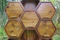 this cabinet has aesthetics asa honey comb looking, which would suit to be with kids. but the issue is that because it is hexagonal it does not have that much space. the wood on this is hard, and it seems that each hexagon are made individually and glued together