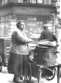 woman selling hot chestnuts in Soho London. There were men doing exactly this in the when I came to London. Does anyone know when it stopped? I was actually saying very recently how I haven't seen one for years ! Vintage London, Victorian London, Old London, London Photos, Photos Du, Old Photos, Old Pics, Rare Photos, Vintage Pictures
