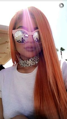 This is actually a nice picture with her peach hair glasses and the light. Kylie jenner