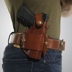 Using an innovative belt slide system, the Ironhide can be used for both strongside or crossdraw carry. Fully ambidextrous, the Ironhide also allows carry in four different positions by unsnapping the holster from the belt slide, moving the belt slide to Ccw Holsters, Pistol Holster, Leather Holster, Concealed Carry Badge, Cross Draw Holster, Custom Leather Belts, Leather Working Patterns, Leather Suspenders, Leather Projects