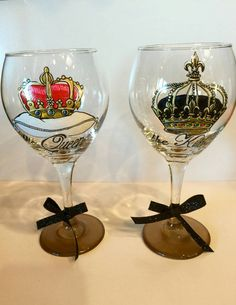 Check out this item in my Etsy shop https://www.etsy.com/listing/262791388/king-and-queen-regal-crown-wine-glasses