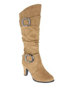 Reboot a look with this chic buckled pair! Featuring a tall fit and a low stacked heel for minimal-maintenance style, the stomping shoe is a sweet choice for every day wear.3'' heel14'' shaft16'' circumferenceMan-madeImported