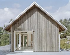 Built by M.B.A. in Uddevalla, Sweden with date 2013. Images by Mikael Olsson. A house that is close to traditional farm houses in Sweden in its form.      The outside is clad in untreated wood, ...