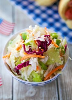Nine-Day Slaw Recipe - great make ahead side dish for a cookout - can keep in the refrigerator for up to 9 days! Slaw tossed in a simple dressing of sugar, vinegar, oil, salt and mustard seeds. One of the best slaw recipes we've made!