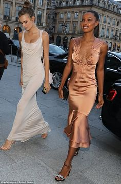 The Angels have landed! Jasmine Tookes wowed when she made a glamorous arrival in a burnt orange dress in the good company of the stunning Josephine Skriver for the Harper's Bazaar 150th anniversary at Hotel Ritz, Paris on Friday