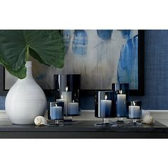 We've added the allure of deep blue to our popular London glass hurricane, a Crate and Barrel classic. Handcrafted large glass hurricane is a modern classic look with a straight-sided silhouette on a short pedestal base. Blue Living Room Decor, Blue Home Decor, White Decor, Classic Home Decor, Classic House, Modern Classic, Hurricane Candle Holders, Hurricane Glass, London Blue