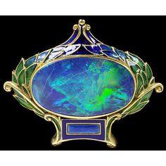 Art nouveau style opal and enamel brooch.
