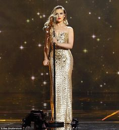 Perrie the pin-up: Perrie Edwards oozed Hollywood glamour in a gold embellished gown as she led her Little Mix bandmates at the Royal Variety Performance which was filmed at the Royal Albert Hall in London last month