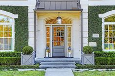Such a pretty entrance, love the color scheme, the trimmed ivy and the awning. Via Cote de Texas