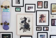 In the entrance area hangs a skateboard, painted for Irene by her friend Natas Kaupas, a pro skateboarder (and it doesn't leave the wall, even for beloved guests.) She used black frames to unify the artwork on the rest of the wall.