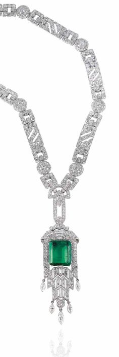 ART DÉCO EMERALD AND DIAMOND NECKLACE, 1930S. Rectangular cut-cornered emerald, vari-cut diamonds, platinum and gold (French marks), detachable in four parts.