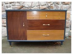 Two tones of stain give an extra pop to this mid century modern credenza.
