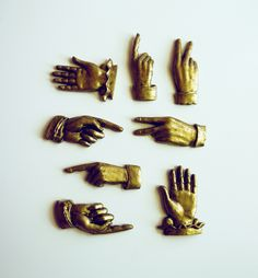 darcydubose:    quillandfox:    These are the lovely set of the gold brass like hands I used to style the Odd Fellows Wedding Set with. It unfortunately doesn't come with the suite itself. I foundthemwhile shopping the other day and immediately thought they would be perfect for the shoot. I seriously wanted to use all of the hand symbols in it!    We sell packs of these at my craft shop. I keep meaning to buy them up!