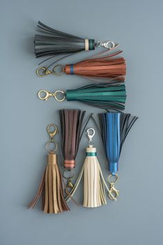 Gorgeous DIY Leather Tassels - Gift Them to Everyone You Know! Gorgeous DIY Leather Tassels - Gift Them to Everyone You Know! Easy DIY Leather Tassels - Use a Cricut Machine for the cutting! Leather Keychain, Leather Earrings, Leather Jewelry, Beaded Jewelry, Fine Jewelry, Leather Diy Crafts, Leather Gifts, Leather Craft, Diy Leather Projects