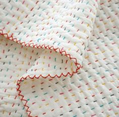 A Quilt For The Bun | Young House Love / hand-stitched, stripey quilt