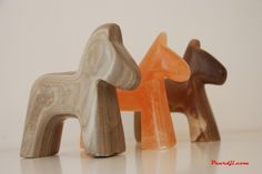 3 stone sculpted hores by Paardji
