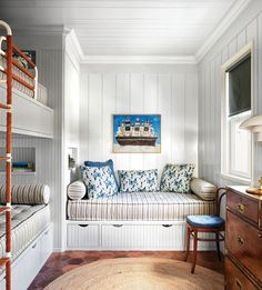 This overflow guest room is outfitted like a ship, with custom bunk beds and bedding from Matouk.