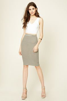 A ribbed knit midi skirt featuring an allover striped pattern and an elasticized…