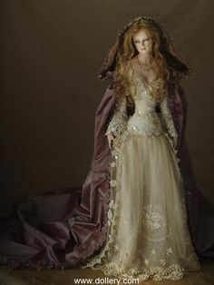 I know it's a doll but I like the dress. Tom Francirek Collectible Dolls