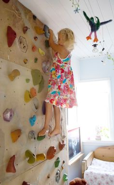 Playroom climbing wall.  Wonder if Jared would go for this??  It might keep them off the furniture!  And it would be way cooler for Owen to say he broke his wrist falling off his climbing wall than a chair...